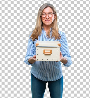 Senior beautiful woman with a vintage box