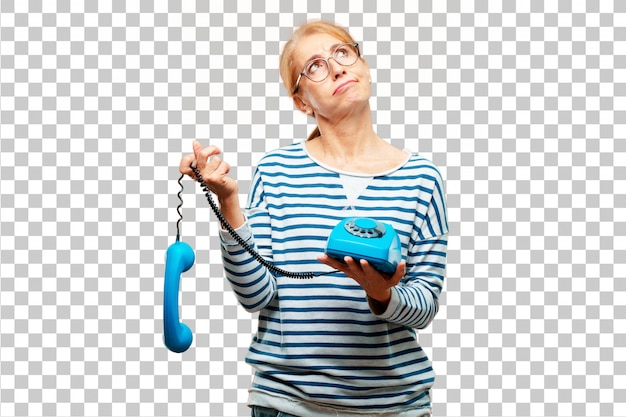 Senior beautiful woman with a vintage telephone
