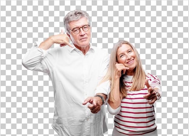 Senior cool husband and wife making a phone call gesture