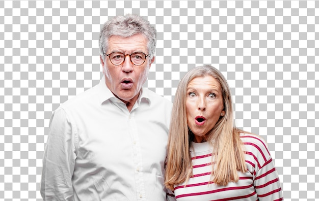 Senior cool husband and wife with a surprised, amazed expression and mouth wide open in shock.