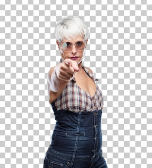 Senior cool woman looking angry and surprised, shouting and pointing forward, towards you