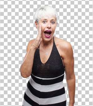 Senior cool woman shouting loud like crazy, calling with hand with an angry expression