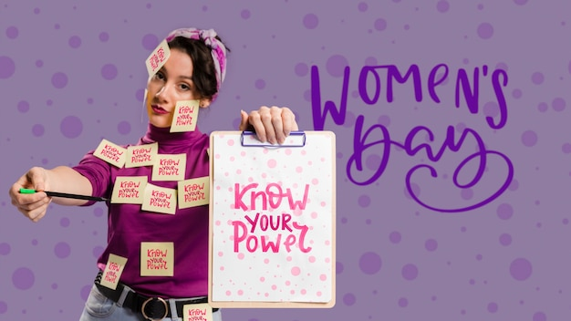Serious woman holding clipboard mock-up