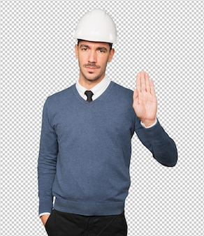 Serious young architect making a gesture of prohibition with his hand