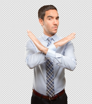 Serious young businessman doing a prohibition gesture