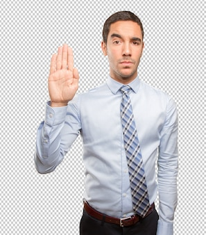 Serious young man doing a stop gesture