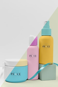 Set of mock-up beauty products with ribbon