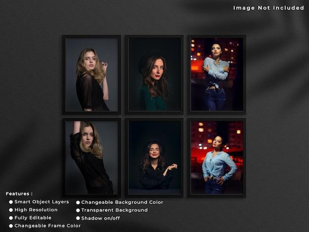 그림자가 있는 벽 배경에 매달려 있는 검은색 세로 사진 프레임 모형 세트입니다.