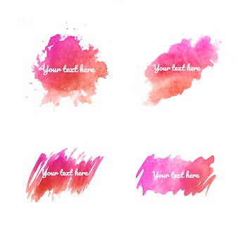 A set of pink watercolor stains on white background