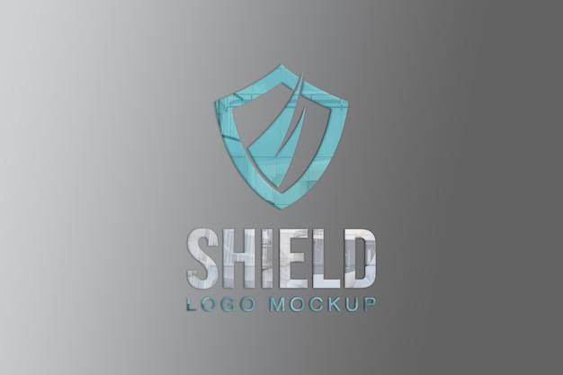 Shield logo mockup on wall