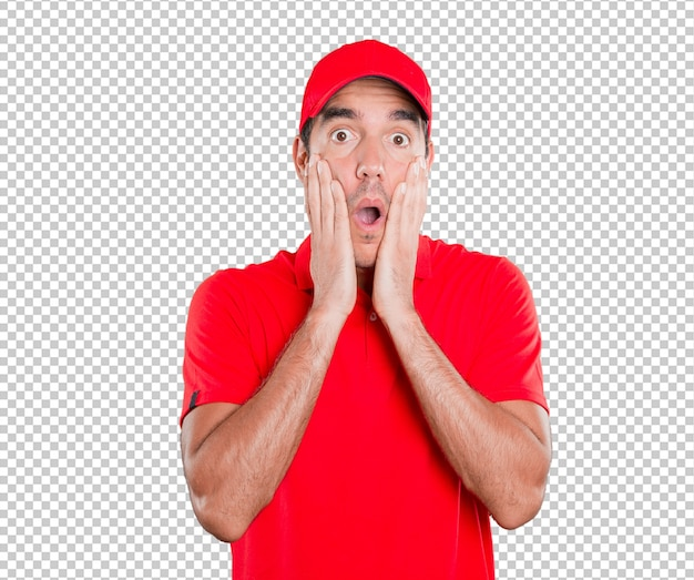 Shocked delivery man posing