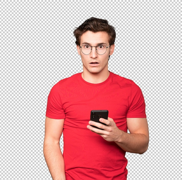 Shocked young man using a mobile phone