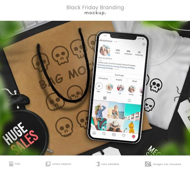 Магазин-макет фирменного стиля с футболкой, сумкой для покупок и смартфоном