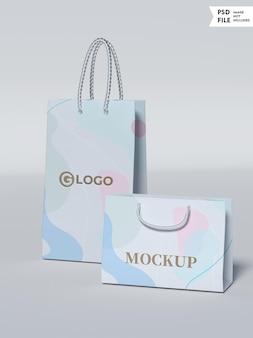 ゴールドカラーのロゴが付いたショッピングバッグのモックアップ