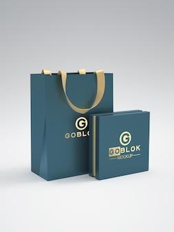 골드 컬러 로고가 있는 쇼핑백 모형