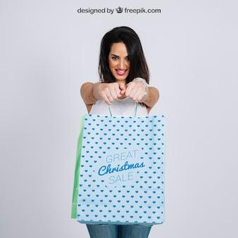 Shopping bag mockup with stylish woman