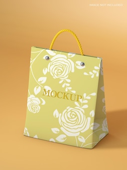ゴールドカラーのロゴのモックアップが付いたショッピングバッグ