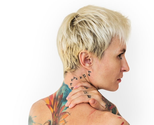 Shorthaired blond woman with tattoos