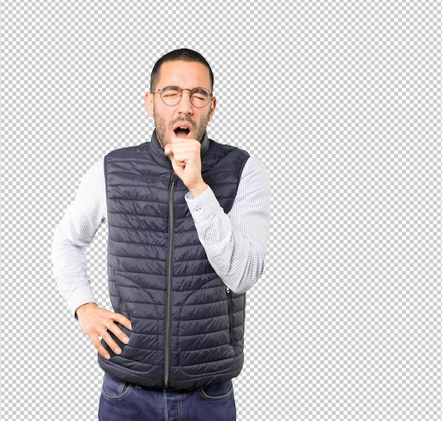 Sick young man coughing