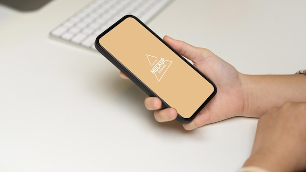 Side view of female hand with smartphone mockup