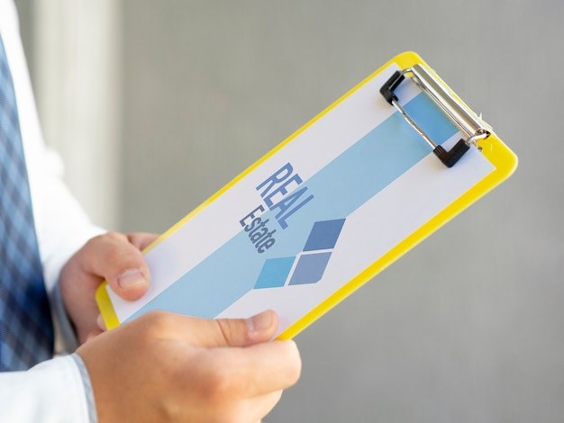 Side view man holding a clipboard mock-up