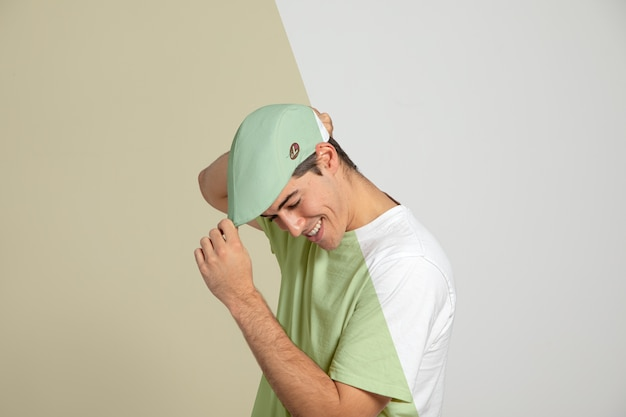 Side view of man touching his cap