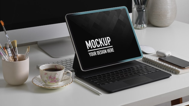 Side view of office desk with tablet mockup