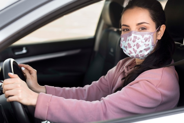 Side view woman with mask driving
