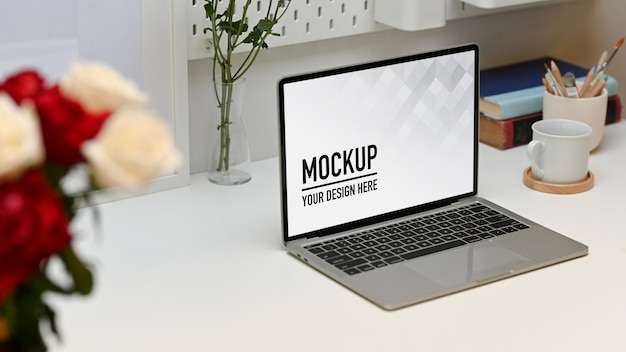 Side view of worktable with laptop mockup