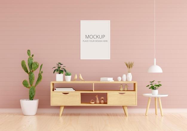 フレームモックアップとピンクのリビングルームのサイドボード