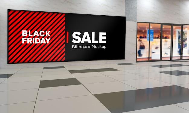 블랙 프라이데이 판매 배너가있는 쇼핑 센터의 벽 모형에 사인 보드