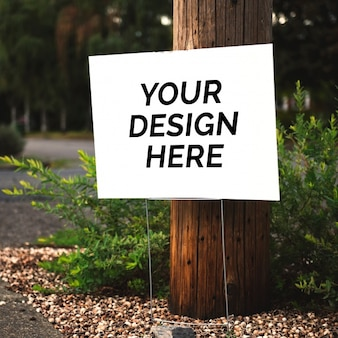 Sign mockup with tree behind