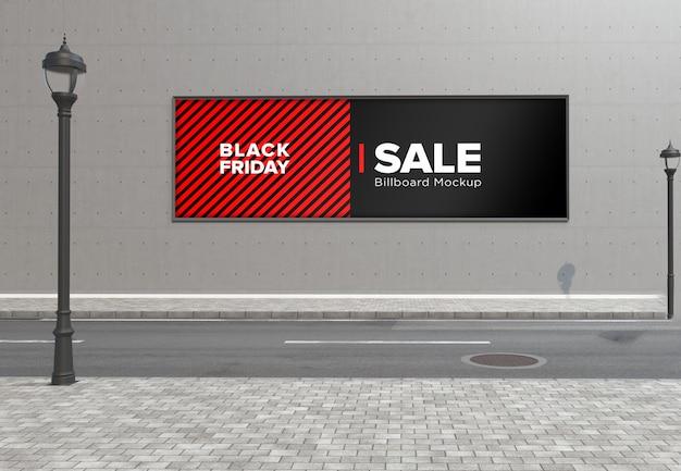 ブラックフライデーのセールバナーと壁の道路標識のモックアップの看板