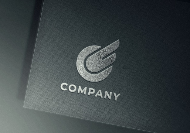 Silver embossed logo mockup on gray textured paper