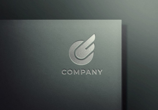 Silver embossed logo mockup on gray textured paper Premium Psd