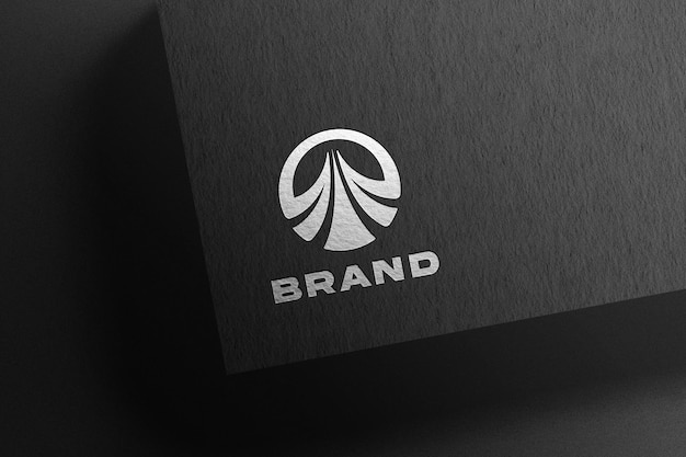 Silver logo mockup on black paper