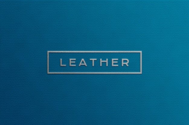 Silver logo mockup on blue color leather