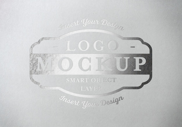 Silver pressed logo mockup on white paper texture