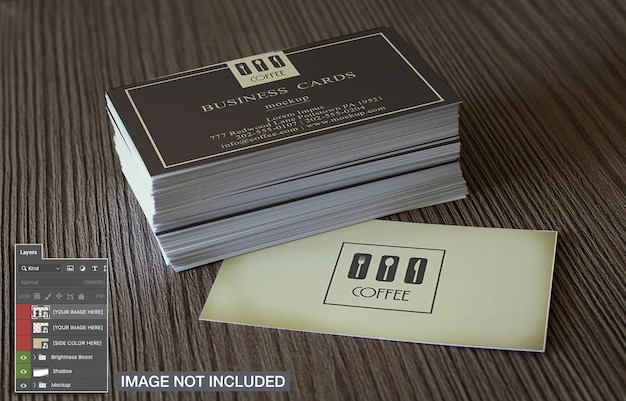Simple business cards on wooden surface mockup