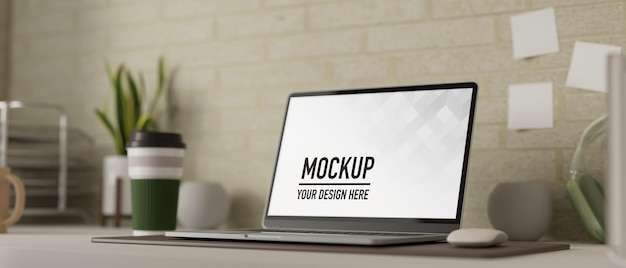ノートパソコンのモックアップを備えたシンプルなワークスペース