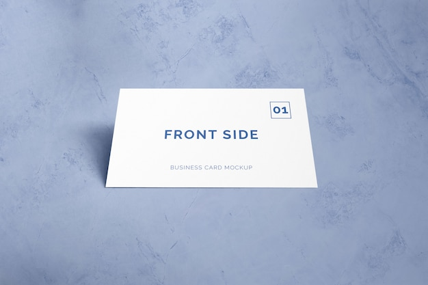 Single business card laying on marble mockup