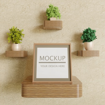 Single square frame mockup on wooden wall shelf with plants
