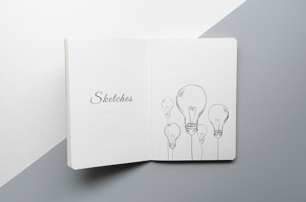 Sketch book on bicolored background