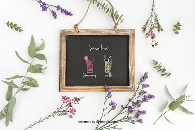 Slate mockup design with decorative plants