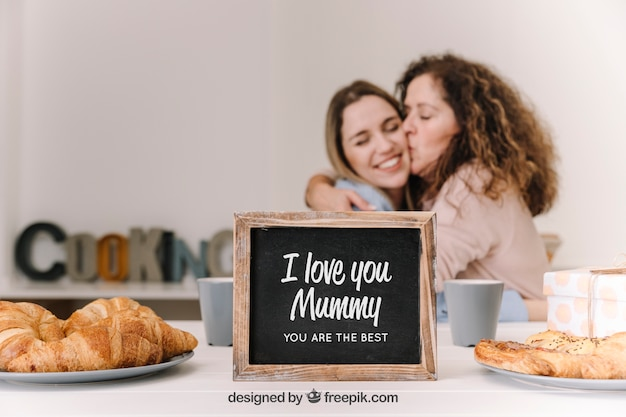 Slate mockup for mothers day with breakfast and kiss