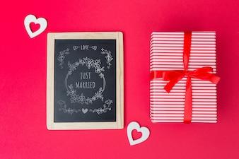 Slate mockup next to gift box for valentine