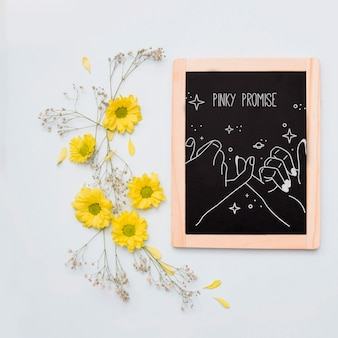 Slate mockup with floral decoratio