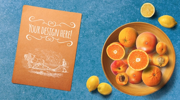 Sliced citrus fruits top view mockup