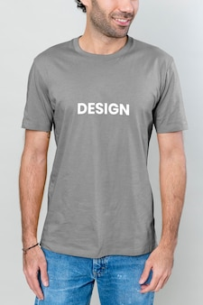 Slim man in a blue t-shirt and jeans mockup