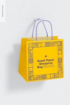 小さな紙の買い物袋のモックアップ、ぶら下げ